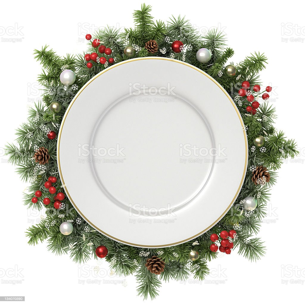 Plate in a Christmas wreath. stock photo