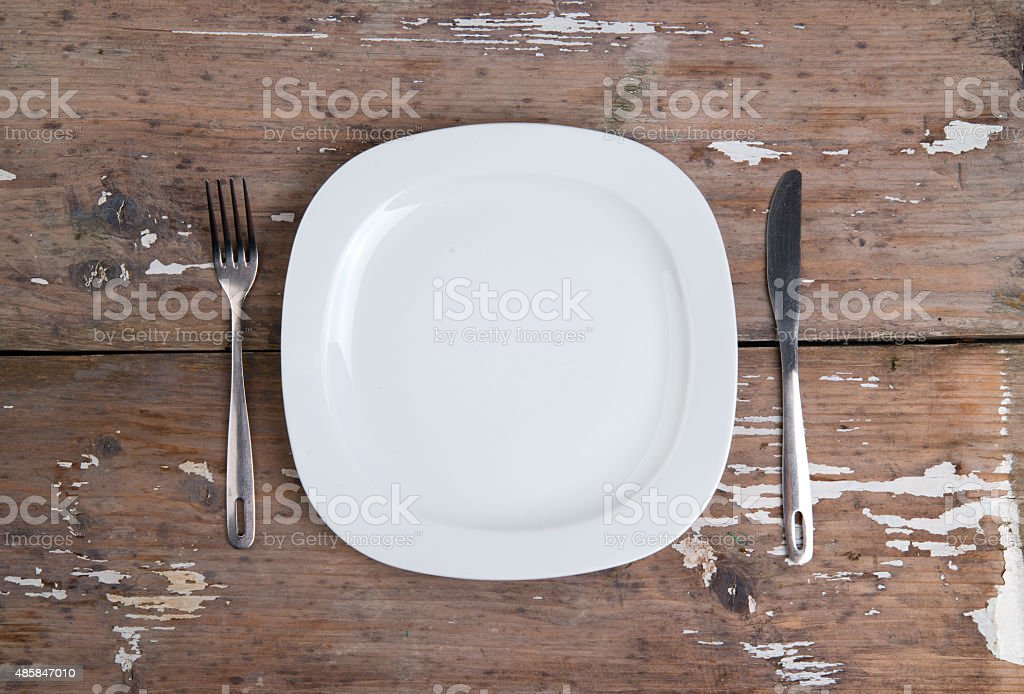 Plate knife and cork stock photo