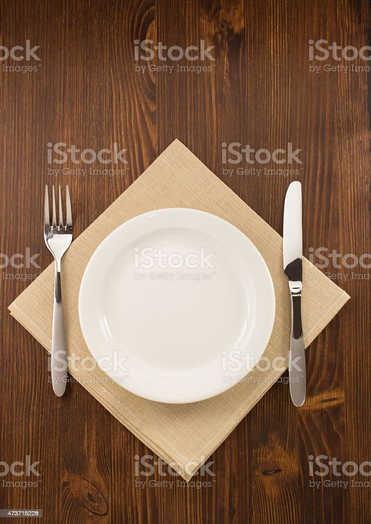 plate, knife and fork  on wood stock photo