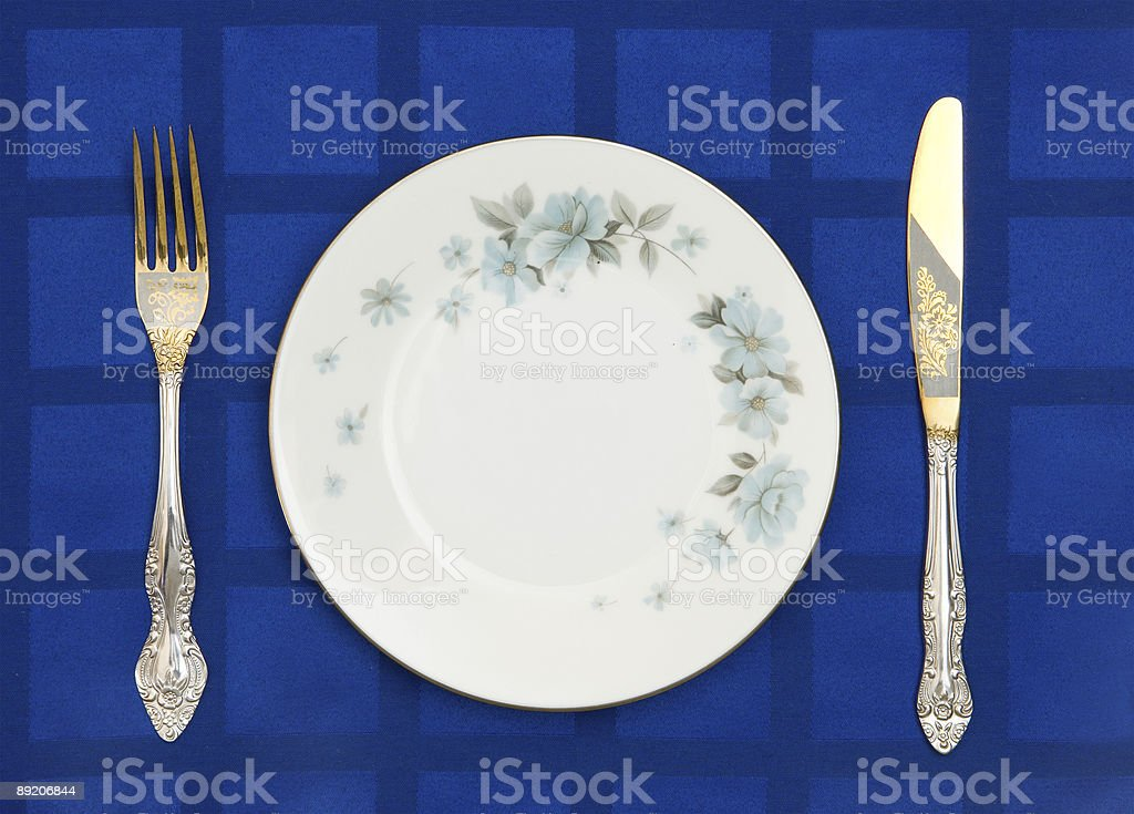 Plate, knife and fork royalty-free stock photo