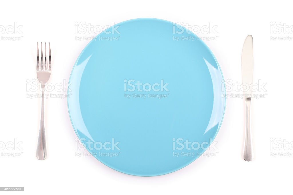 A plate, knife and fork set at a table stock photo