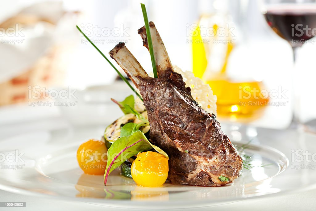 Plate of a restaurant lamb chops dish stock photo