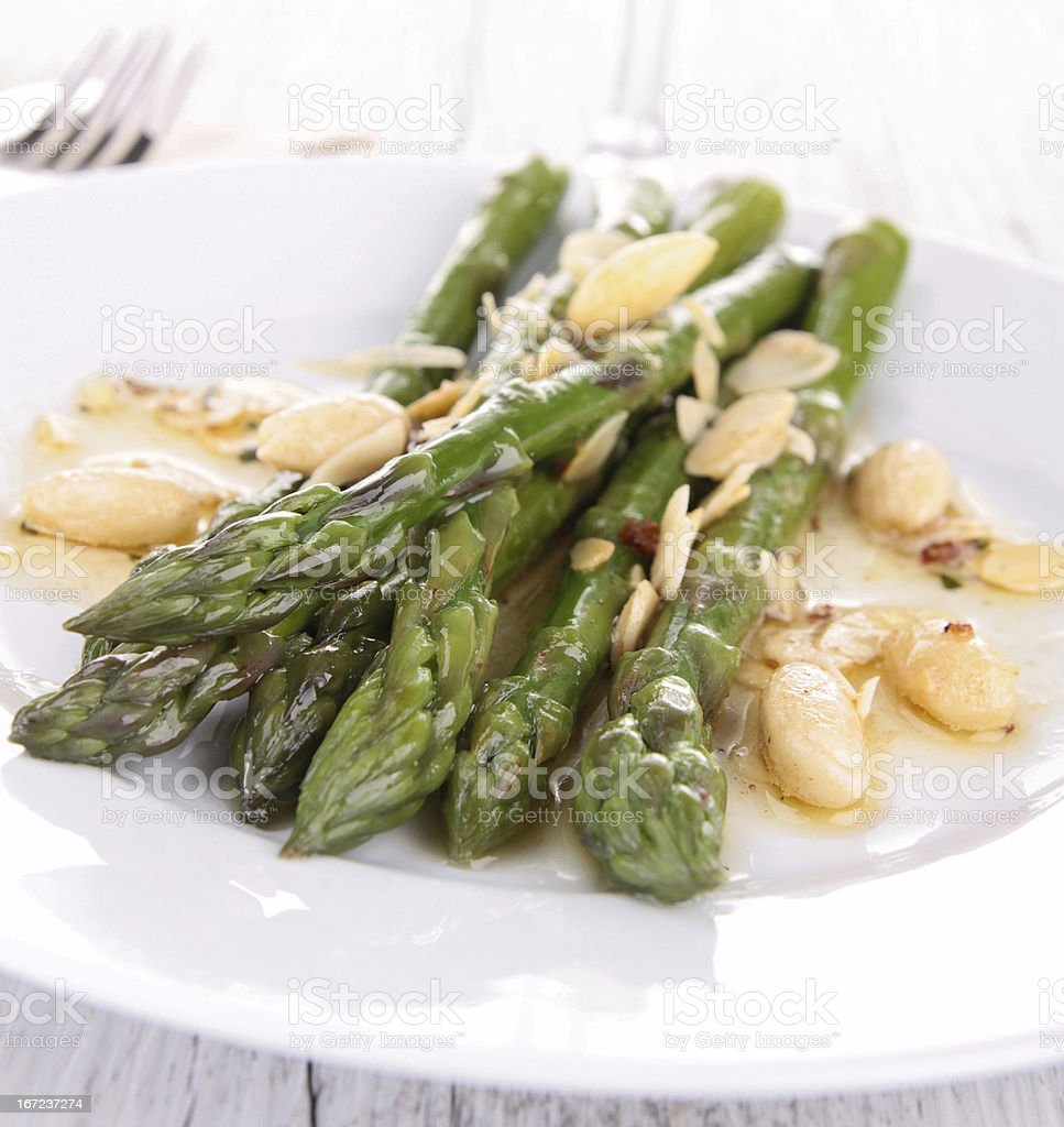 plate of asparagus with almonds royalty-free stock photo