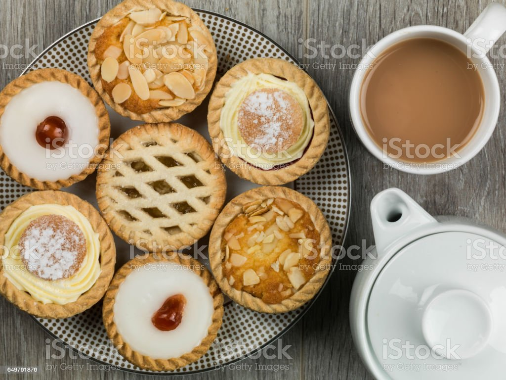 Plate of Assorted Individual Dessert Cakes or Tarts stock photo