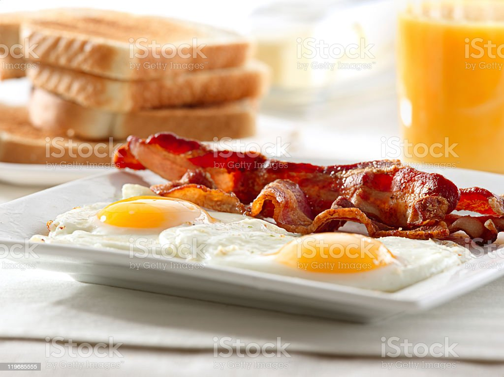 A plate of bacon and eggs with toast stock photo