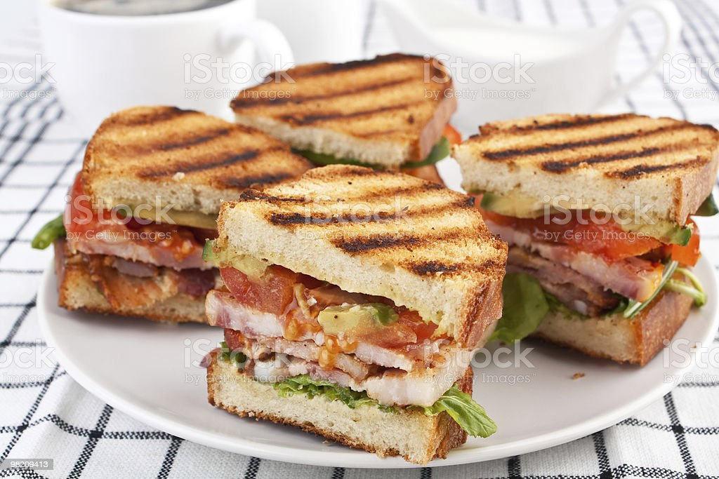 Plate of bacon, lettuce, and tomato sandwiches stock photo