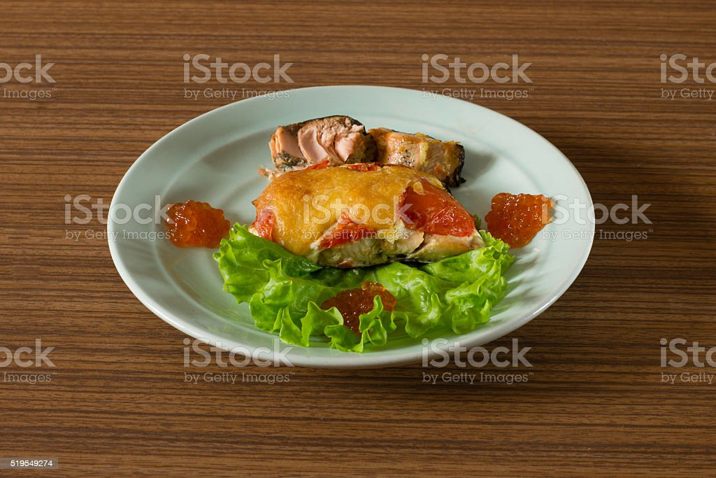 plate of baked fish, vegetables and caviar stock photo