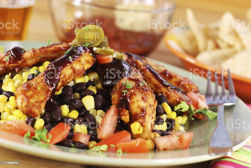 A plate of barbecue chicken mixed with vegetables royalty-free stock photo