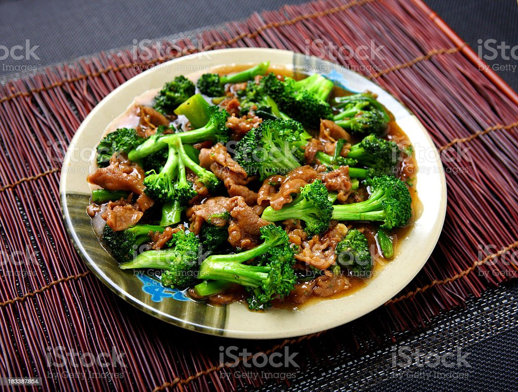 A plate of beef broccoli dish on top of table ready to eat royalty-free stock photo