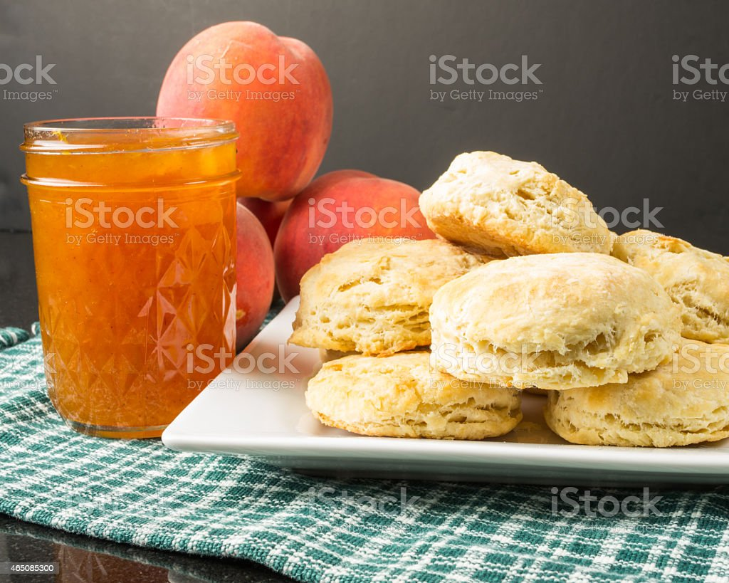 Plate of biscuits with peach jam stock photo