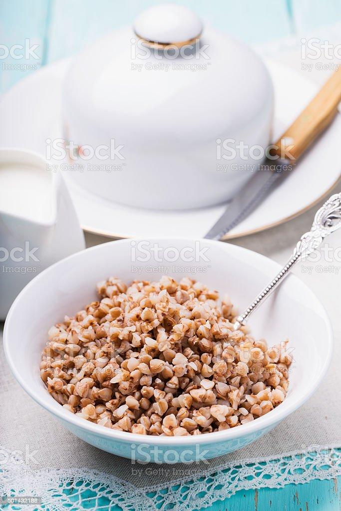 Plate of buckwheat porridge with milk stock photo