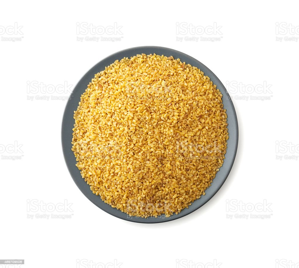 Plate of bulgur isolated on white background stock photo