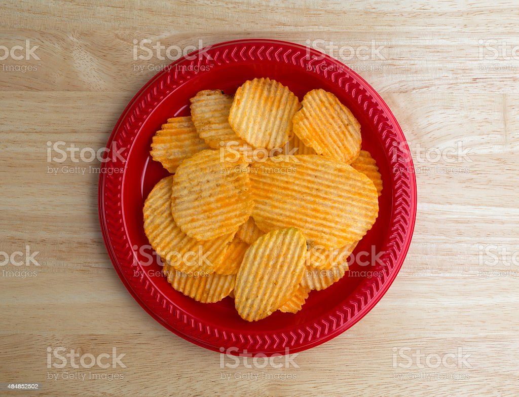 Plate of cheddar cheese flavored potato chips stock photo