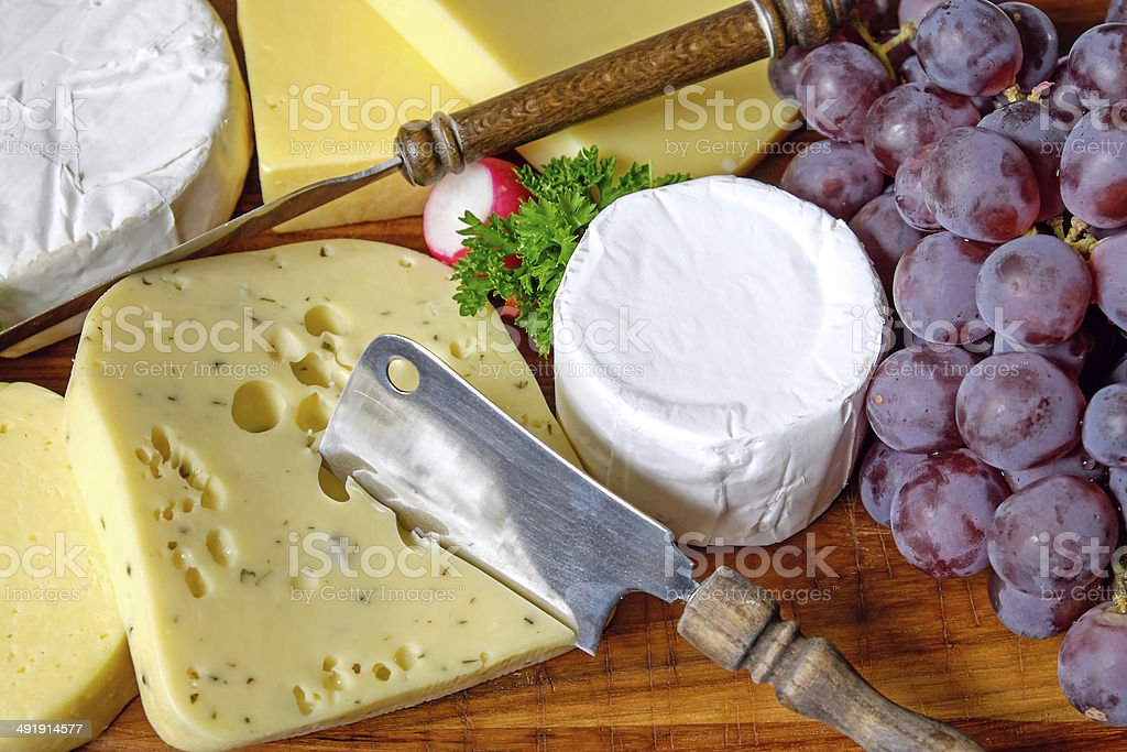 Plate of cheese and grapes royalty-free stock photo