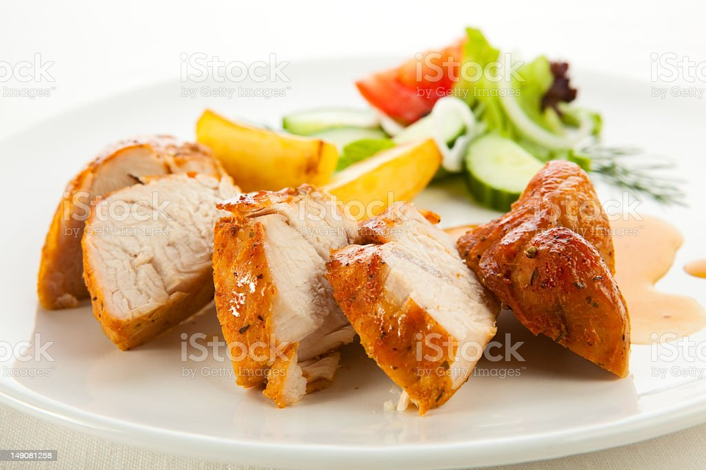 A plate of chicken and vegetables stock photo