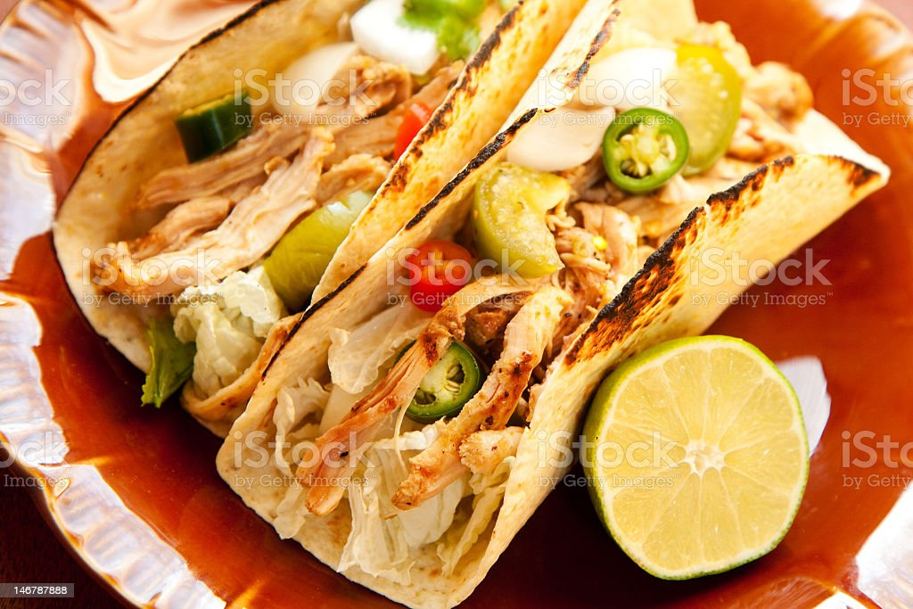 Plate of chicken tacos with half a lime stock photo
