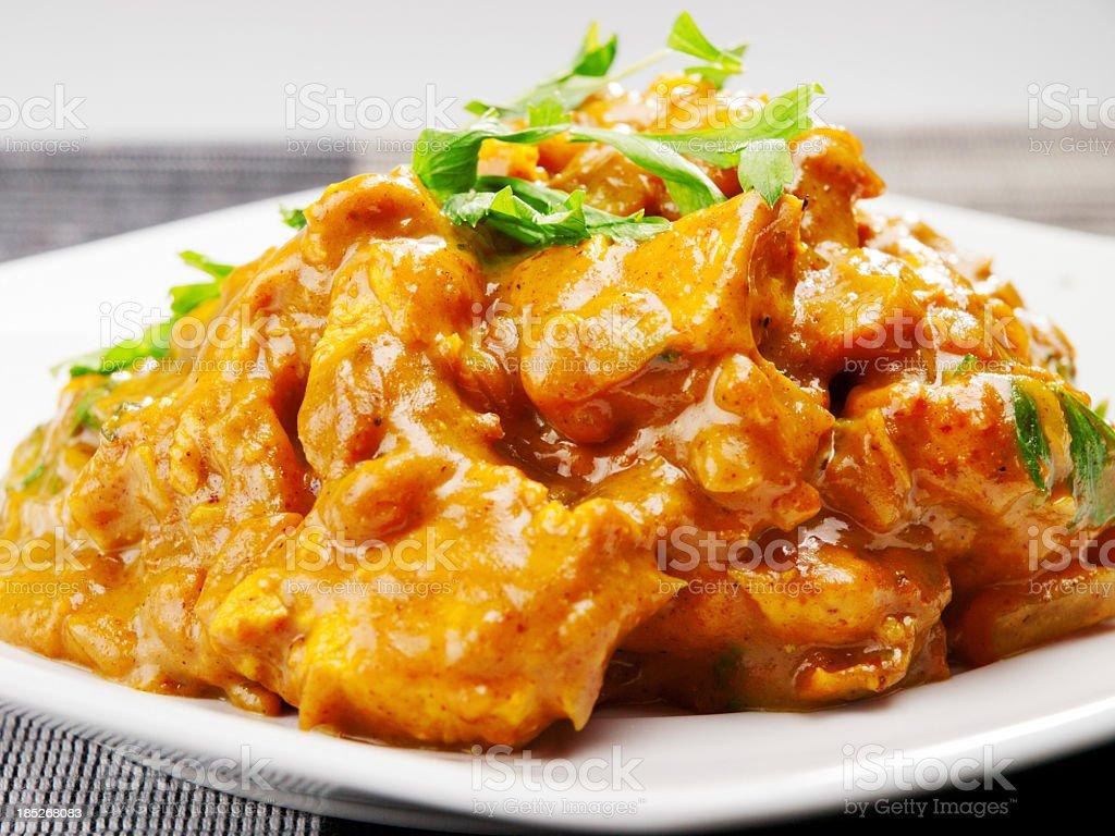 Plate of chicken tikka masala with garnish stock photo