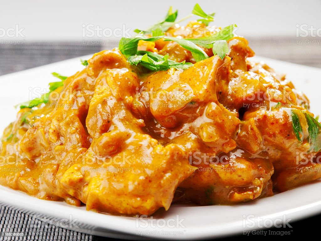Plate of chicken tikka masala with garnish stock photo