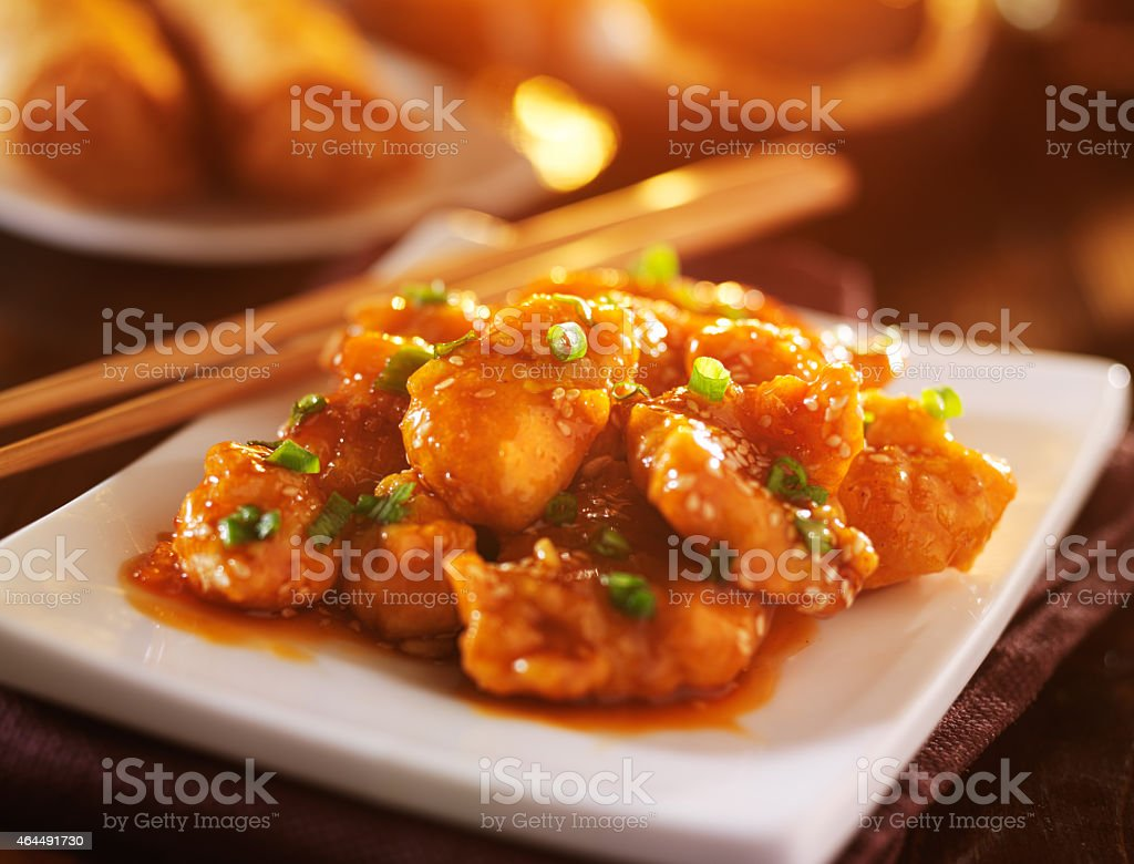 plate of chinese sesame chicken take out stock photo