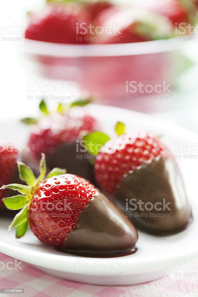 A plate of chocolate dipped strawberries stock photo