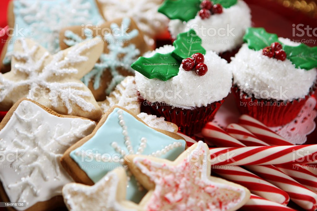 A plate of Christmas cookies, cupcakes and candy canes stock photo