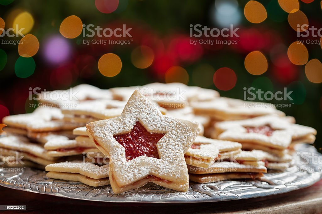 Plate of Christmas cookies under lights stock photo