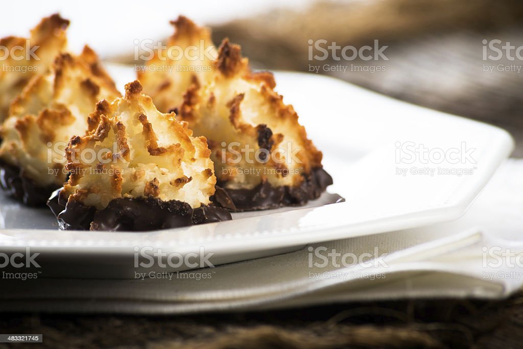 Plate of coconut chocolate macaroons stock photo