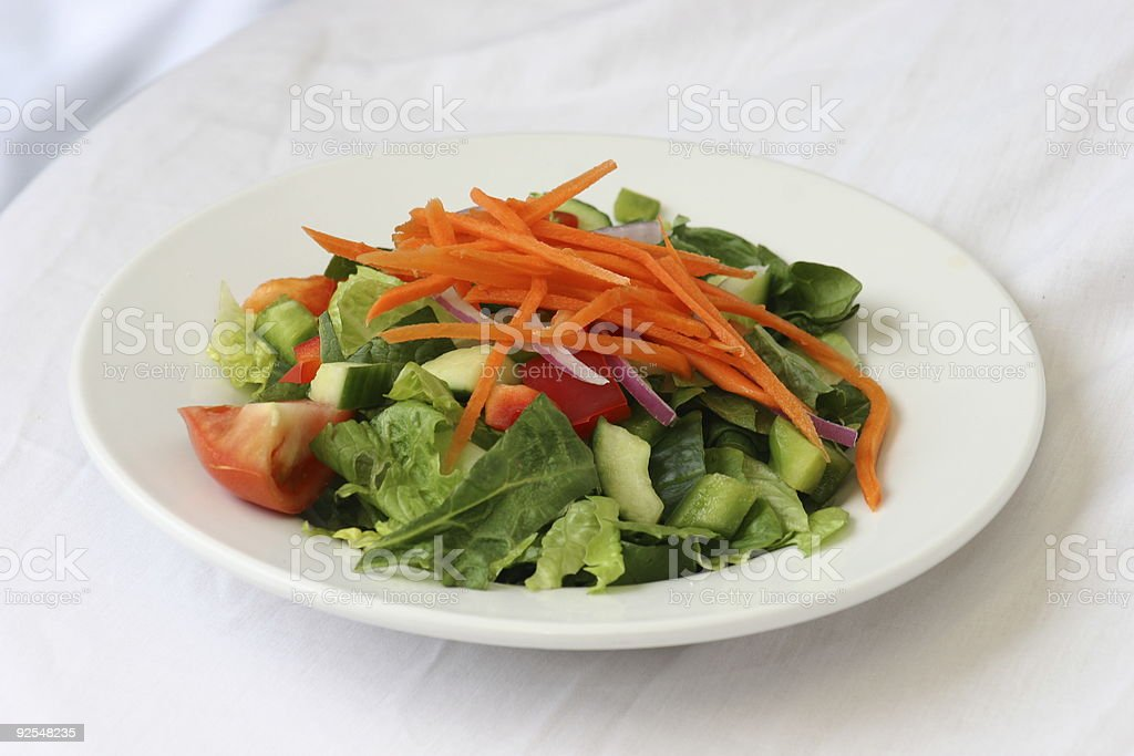 A plate of colorful salad on a white background royalty-free stock photo