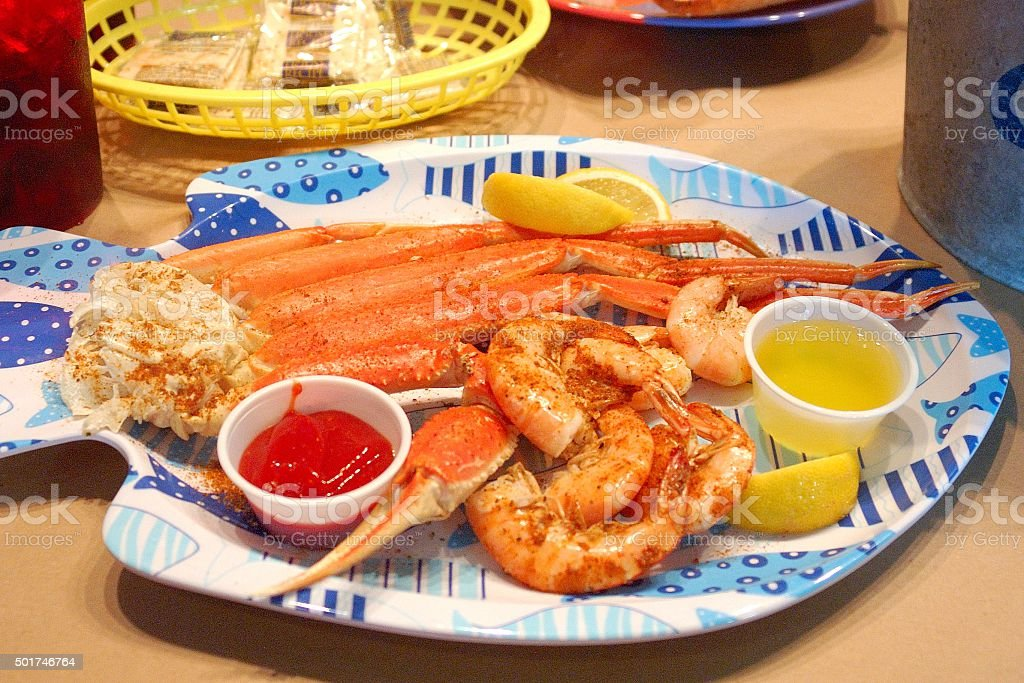 Plate of crab legs and shrimp ready to eat stock photo