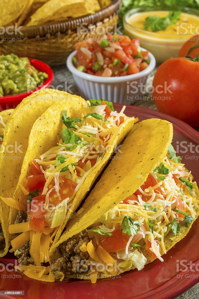 plate of crispy beef tacos stock photo