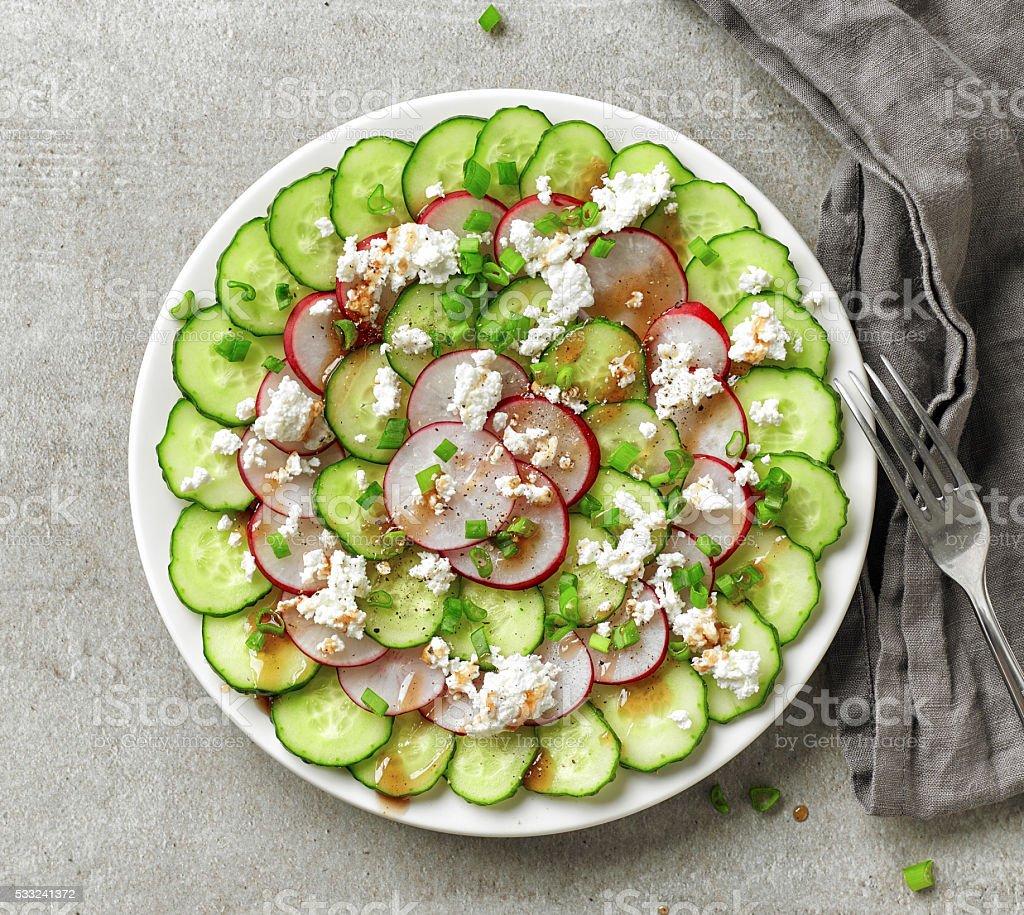 Plate of cucumber and radish salad stock photo