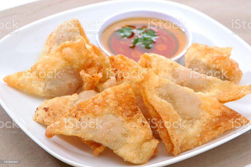 Plate of deep fried wontons with dipping sauce royalty-free stock photo