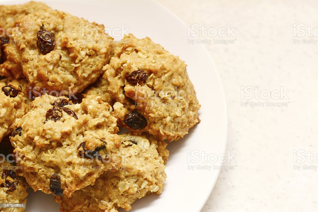 Plate of delicious oatmeal raisin cookies stock photo