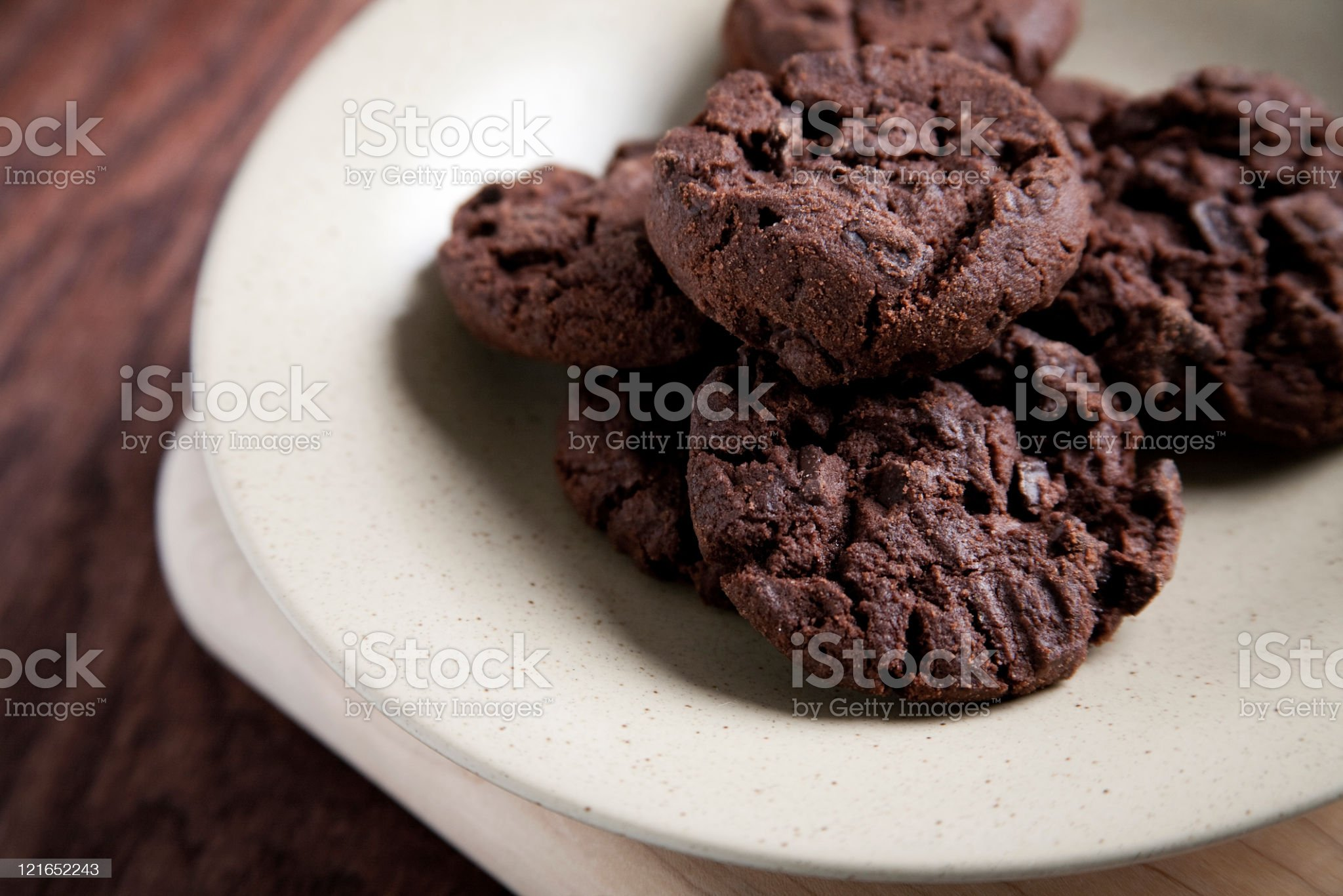 A plate of double chocolate cookies on a wood table royalty-free stock photo