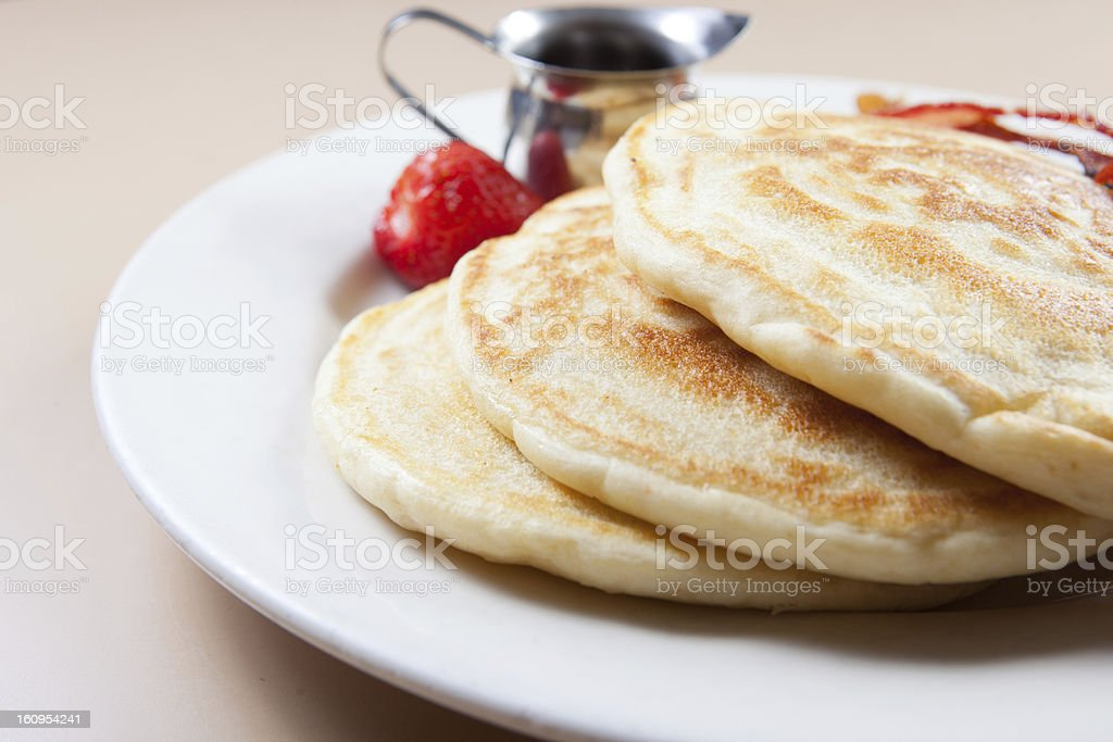 Plate of fluffy pancakes with syrup and bacon royalty-free stock photo
