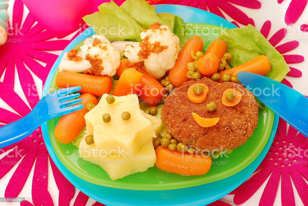 A plate of food arranged in a childish manner royalty-free stock photo