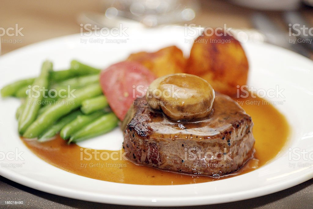 Plate of Food Meat Potatoes Green Beans Gravy Dinner stock photo