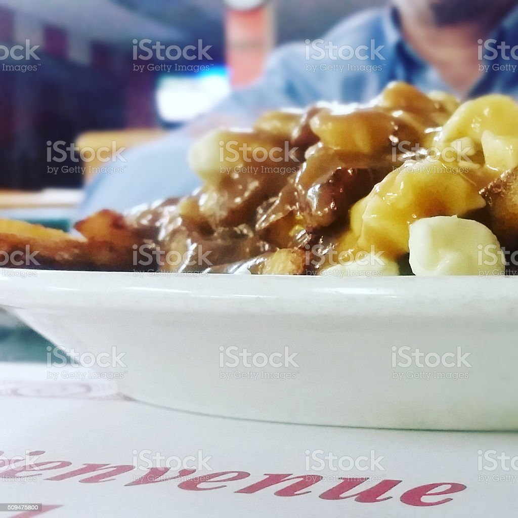 Plate of French Canadian Poutine in Montreal Quebec stock photo