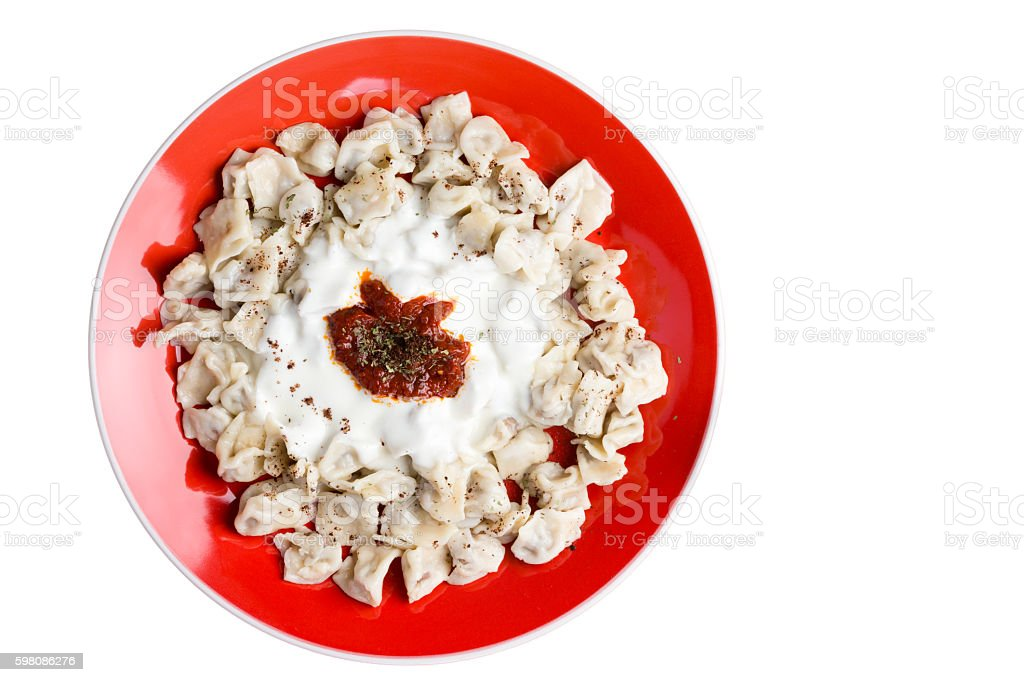 Plate of fresh homemade Turkish manti dumplings stock photo