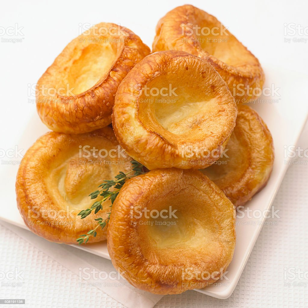 Plate of freshly made Yorkshire puddings stock photo
