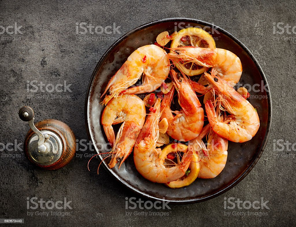 plate of fried spiced prawns stock photo