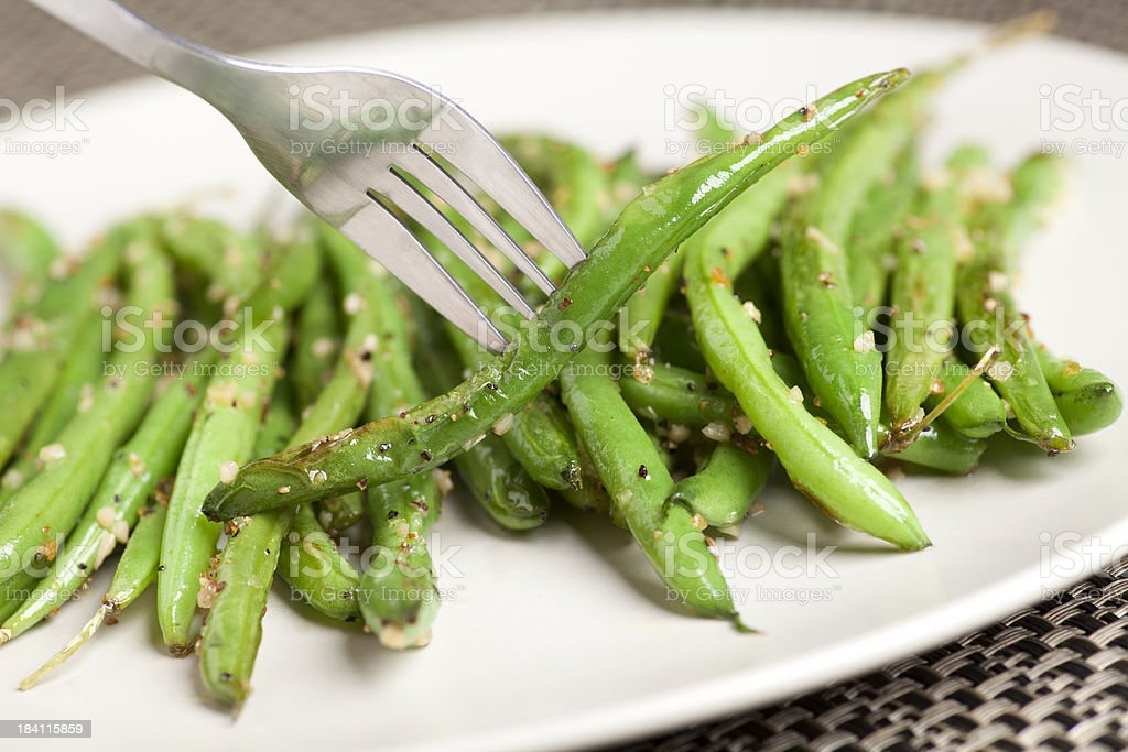 Plate of garlic green beans stock photo