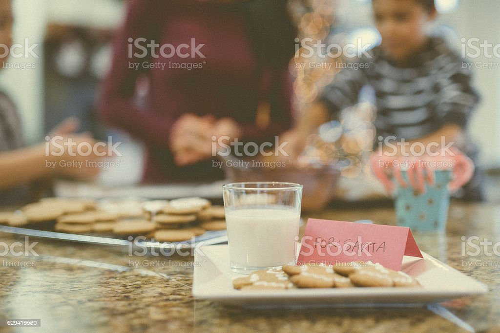 Plate of gingerbread cookies and milk ready for Santa stock photo