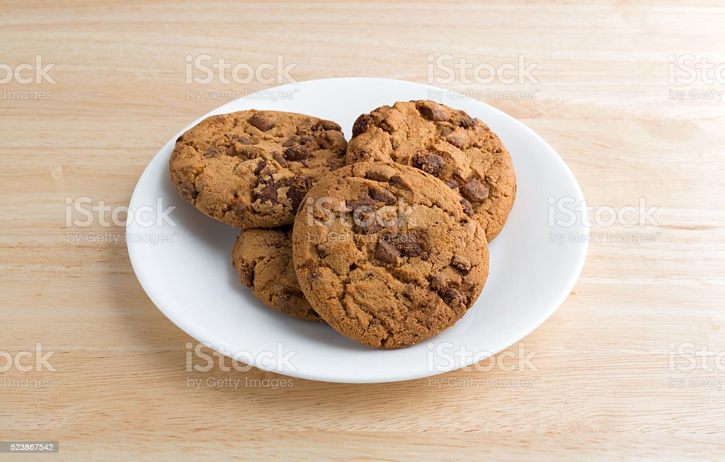 Plate of gourmet milk chocolate chip cookies on table stock photo