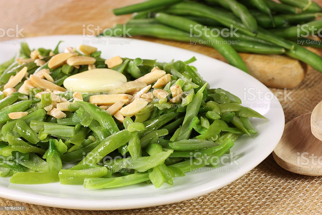 A plate of green beans and almonds royalty-free stock photo