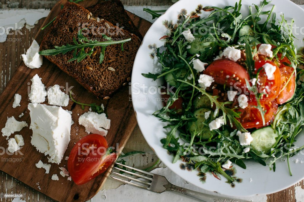 plate of green salad with vegetables stock photo