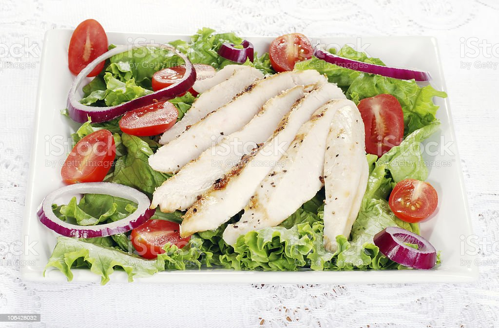 plate of grilled chicken salad royalty-free stock photo