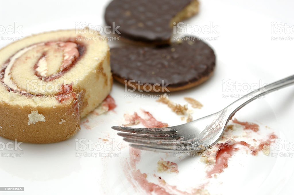 Plate of half eaten cakes: gluttony, binge eating. royalty-free stock photo