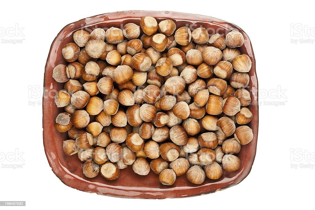 Plate of hazelnuts royalty-free stock photo