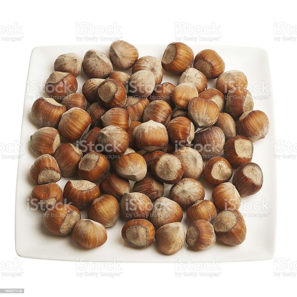 Plate of hazelnuts royalty-free stock photo